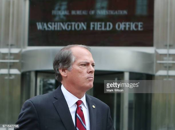 James Wolfe former director of security for the Senate Intelligence Committee walks out from the Washington FBI Field Office after being processed on...