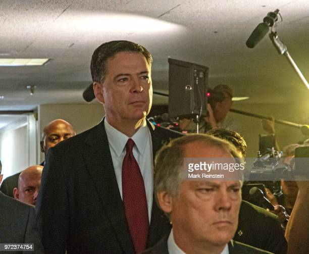 James Wolfe former director of security with the Senate Intelligence Committee escorts former FBI Director James Comey out of hearing room in the...