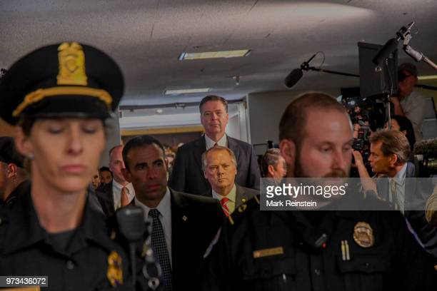 James Wolfe former director of security with the Senate Intelligence Committee escorts former FBI Director James Comey out of the hearing room in the...