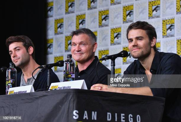 James Wolk Kevin Williamson and Paul Wesley speak onstage at the Tell Me a Story panel during ComicCon International 2018 at San Diego Convention...