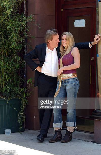 James Wood stands with his girlfriend Ashley Myrick outside Nello Restaurant for lunch on October 19 2005 in New York City