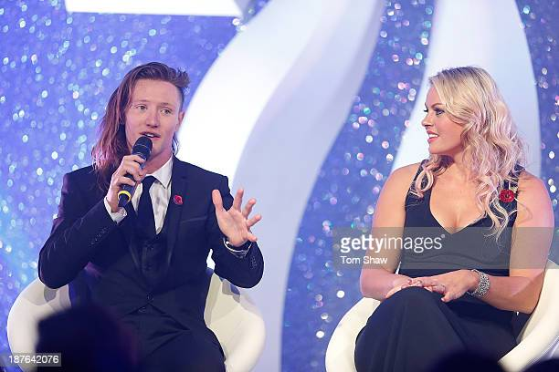 James Woods and Chemmy Allcott of Great Britan talk on stage during the British Olympic Ball at The Dorchester on October 30 2013 in London England