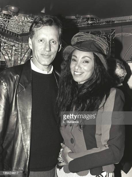 """James Woods and """"Downtown"""" Julie Brown, MTV, VJ during Whitney Houston File Photos - Dec 10 United States."""