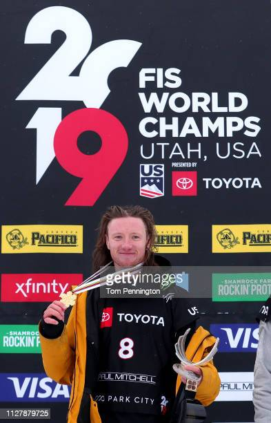 James Woods in first place celebrates on the podium for the Men's Ski Slopestyle Final at the FIS Freestyle Ski World Championships on February 06...