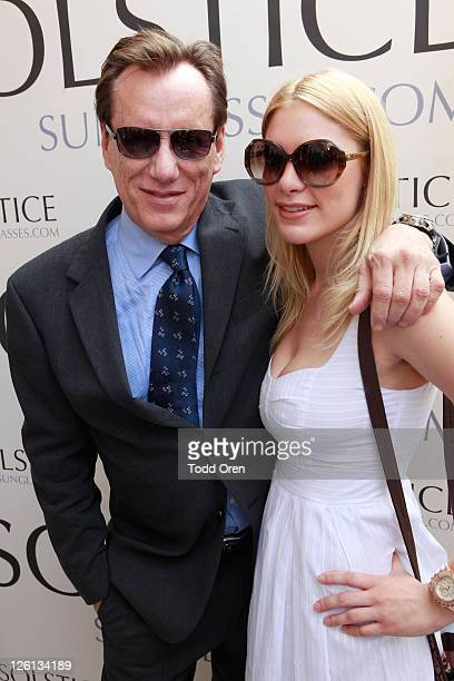 James Woods with Giorgio Armani 929S sunglasses and Ashley Madison with Kate Spade Linette sunglasses at the SOLSTICE and Safilo USA booth during HBO...
