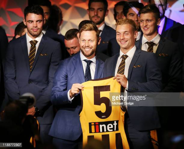 James Worpel of the Hawks accepts his jumper from former player Sam Mitchell during the Hawthorn Hawks AFL season launch at Melbourne Cricket Ground...
