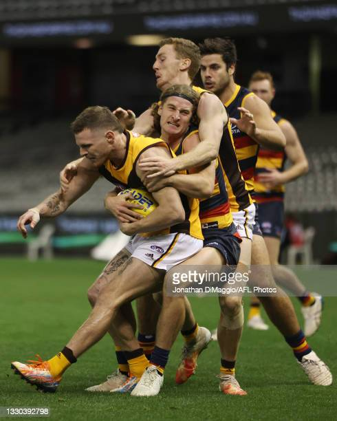 James Worpel of the Hawks is tackled by Sam Berry of the Crows during the round 20 AFL match between Adelaide Crows and Hawthorn Hawks at Marvel...