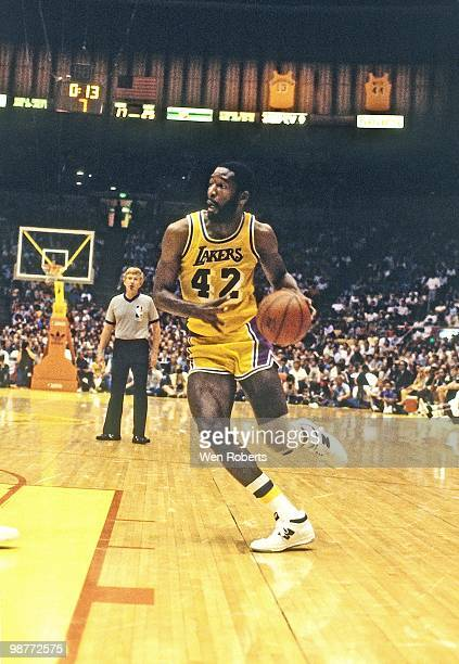 James Worthy of the Los Angeles Lakers drives to the basket during a game played circa 1984 at the Great Western Forum in Inglewood California NOTE...