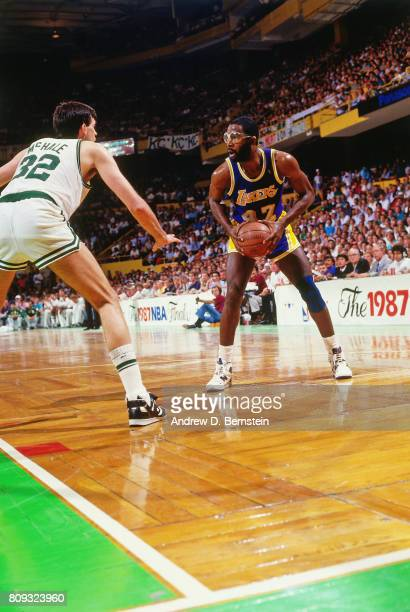 James Worthy of the Los Angeles Lakers handles the ball against Kevin McHale of the Boston Celtics during a game played circa 1988 at the Boston...