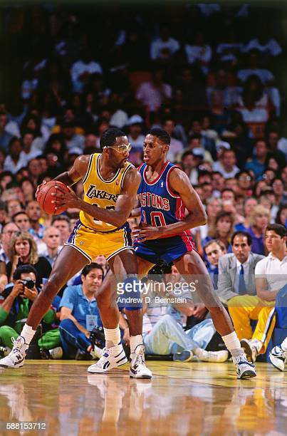 James Worthy of the Los Angeles Lakers handles the ball against Dennis Rodman of the Detroit Pistons during the 1988 NBA Finals at The Forum in Los...