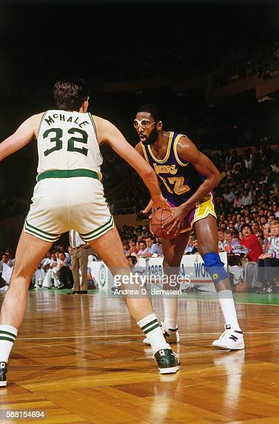 James Worthy of the Los Angeles Lakers handles the ball during a game against Kevin McHale of the Boston Celtics circa 1988 at the Boston Garden in...