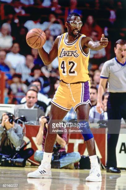 James Worthy of the Los Angeles Lakers signals during an NBA game at the Great Western Forum in 1990 in Inglewood California NOTE TO USER User...