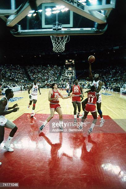 James Worthy of the Western Conference AllStars attempts a shot against Isiah Thomas of the Eastern Conference AllStars during the 1987 NBA AllStar...