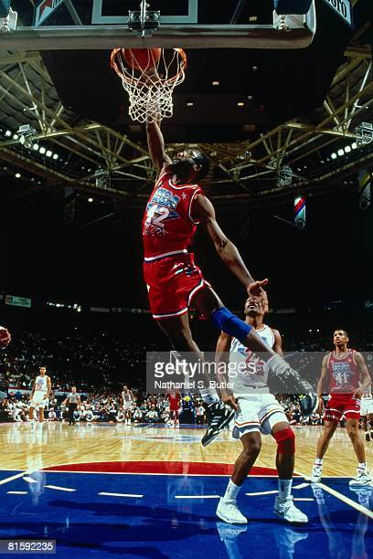 James Worthy of the Western Conference AllStars dunks against Ricky Pierce# 22 of the Eastern Conference AllStars during the 1991 NBA AllStar Game on...