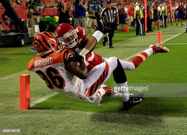 James Wright of the Cincinnati Bengals scores a touchdown against Phillip Gaines of the Kansas City Chiefs during the fourth quarter at Arrowhead...
