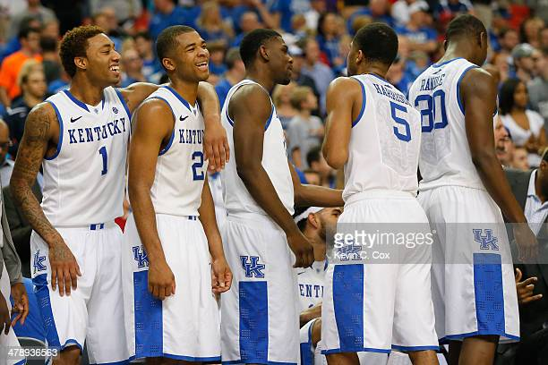 James Young and Aaron Harrison of the Kentucky Wildcats celebrate with teammates in the final moments of their 7058 win over the Georgia Bulldogs...