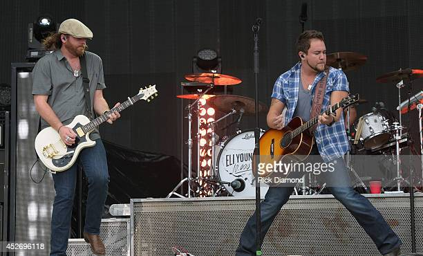 James Young and Mike Eli of Eli Young Band perform at Country Thunder USA Day 2 on July 25 2014 in Twin Lakes Wisconsin