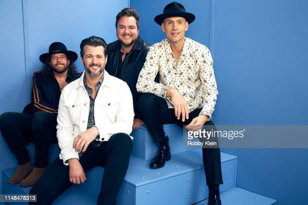 James Young Chris Thompson Mike Eli and Jon Jones of the Eli Young Band pose for a portrait during the 2019 CMT Music Awards at Bridgestone Arena on...