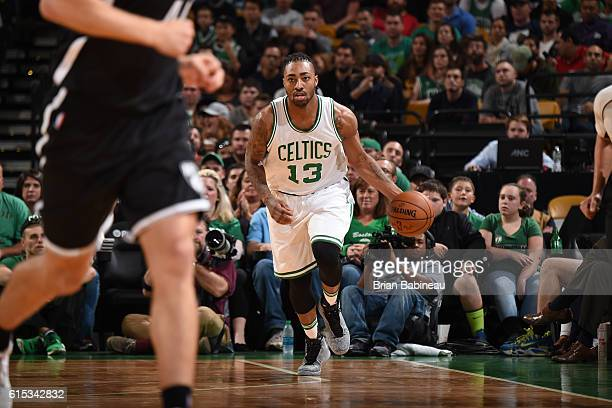 James Young of the Boston Celtics brings the ball up court against the Brooklyn Nets on October 17 2016 at the TD Garden in Boston Massachusetts NOTE...