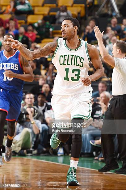 James Young of the Boston Celtics celebrates a play against the Philadelphia 76ers on October 6 2014 at the TD Garden in Boston Massachusetts NOTE TO...