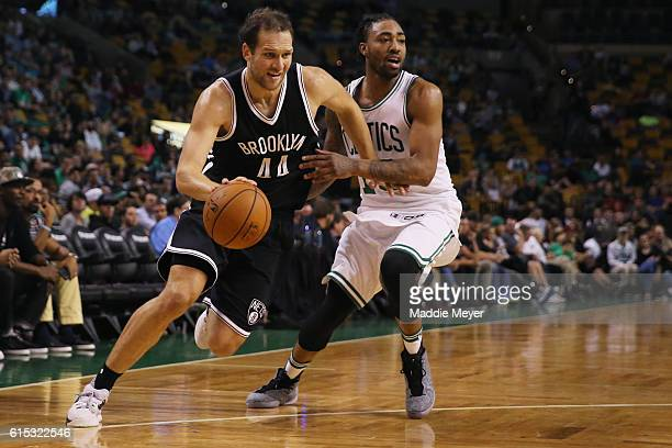 James Young of the Boston Celtics defends Bojan Bogdanovic of the Brooklyn Nets during the fourth quarter of the preseason game at TD Garden on...