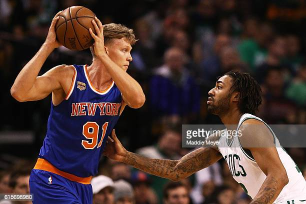 James Young of the Boston Celtics defends Mindaugas Kuzminskas of the New York Knicks during the third quarter at TD Garden on October 17 2016 in...
