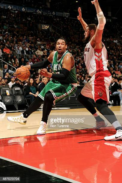 James Young of the Boston Celtics drives against the Toronto Raptors on October 10 2014 at the Air Canada Centre in Toronto Ontario Canada NOTE TO...