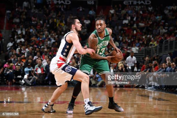 James Young of the Boston Celtics handles the ball during the game against the Washington Wizards during Game Three of the Eastern Conference...