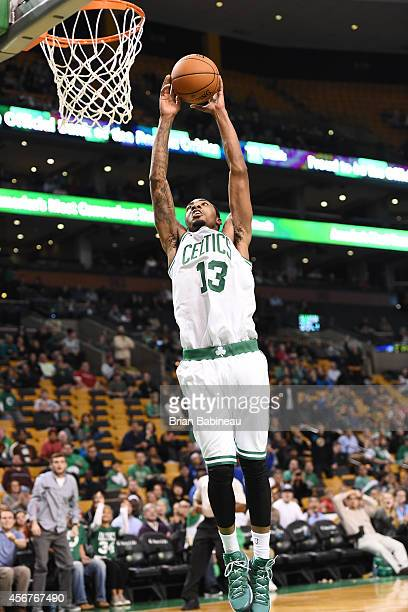 James Young of the Boston Celtics shoots the ball against the Philadelphia 76ers on October 6 2014 at the TD Garden in Boston Massachusetts NOTE TO...