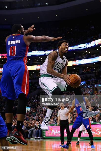 James Young of the Boston Celtics takes a shot with pressure from Andre Drummond of the Detroit Pistons during the fourth quarter at TD Garden on...