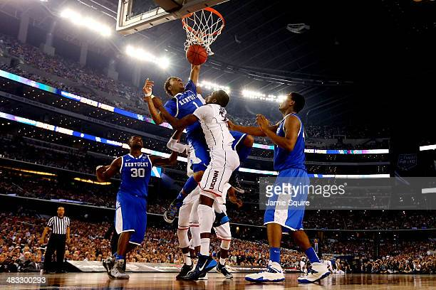 James Young of the Kentucky Wildcats dunks over Amida Brimah of the Connecticut Huskies during the NCAA Men's Final Four Championship at ATT Stadium...