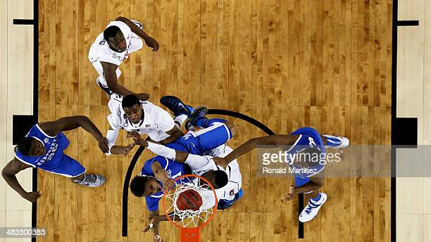 James Young of the Kentucky Wildcats dunks over Amida Brimah of the Connecticut Huskies during the NCAA Men's Final Four Championship at AT&T Stadium...