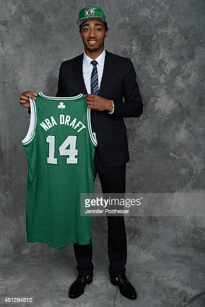 James Young the 17th pick overall by the Boston Celtics poses for a portrait during the 2014 NBA Draft at the Barclays Center on June 26 2014 in the...