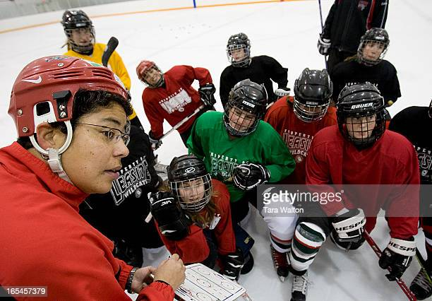 Canadian hockey great Angela James instructs a group of young female players Tuesday evening at a private ice surface located next to the Ted Reeve...