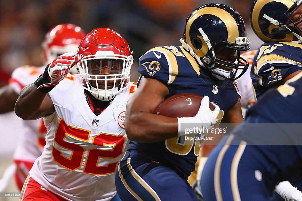 James-Michael Johnson #52 of the Kansas City Chiefs looks to tackle Malcolm Brown #39 of the St. Louis Rams in the fourth quarter during a pre-season game at the Edward Jones Dome on September 3, 2014 in St. Louis, Missouri.