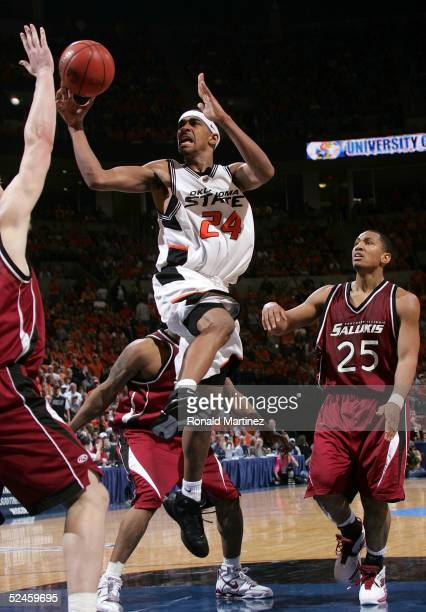 JamesOn Curry of the Oklahoma State Cowboys goes up for a shot in the lane in the second half against the Southern Illinois Salukis during the second...