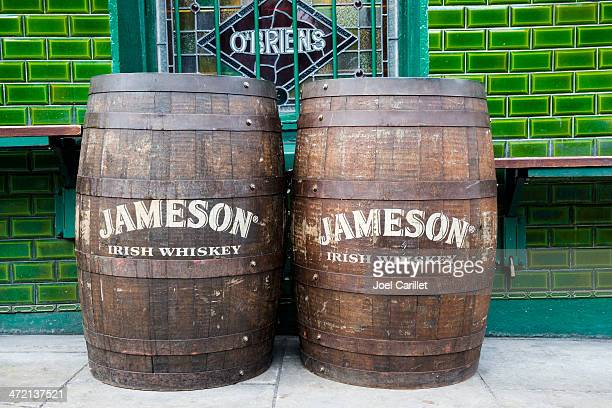 jameson irish whiskey barrels outside pub in dublin - whisky stock photos and pictures