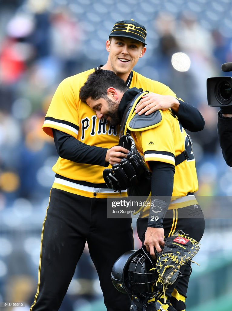 Jameson Taillon #50 celebrates with Francisco Cervelli #29 of the Pittsburgh Pirates after throwing a complete game shutout against the Cincinnati Reds at PNC Park on April 8, 2018 in Pittsburgh, Pennsylvania.