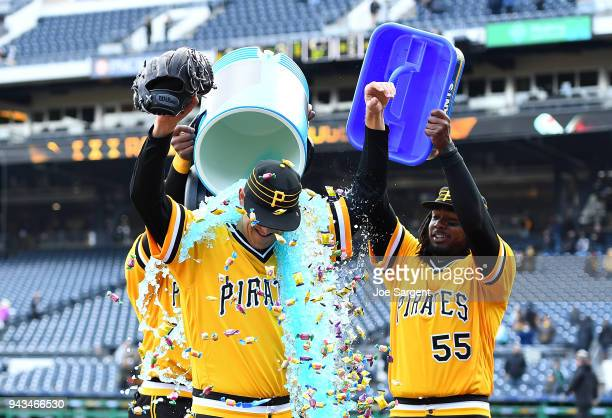 Jameson Taillon is doused with Powerade and bubble gum by Starling Marte and Josh Bell of the Pittsburgh Pirates after throwing a complete game...