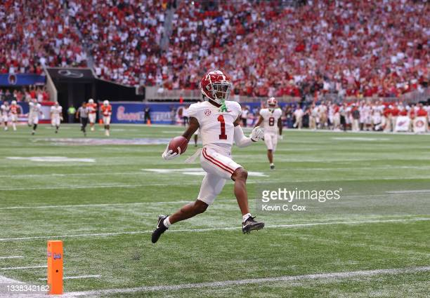 Jameson Williams of the Alabama Crimson Tide reacts as he takes this long reception for a touchdown against the Miami Hurricanes during the second...