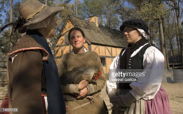 TO GO WITH AFP STORY JAMESTOWNThe birth of a nation 400 years ago Historical interpreters dressed in period dress stop to chat inside James Fort...