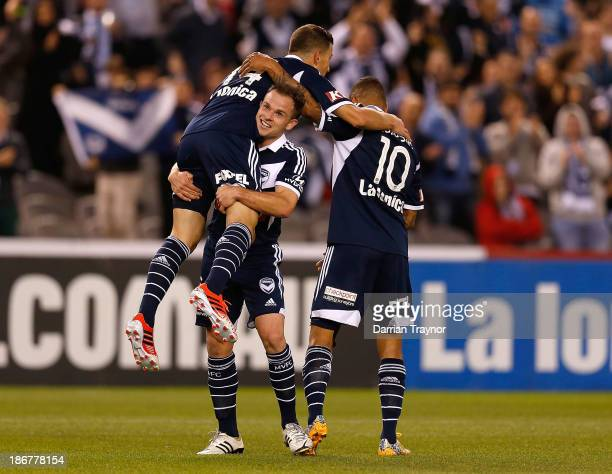 JamesTroisi of the Victory celebrates a goal with team mates during the round four ALeague match between Melbourne Victory and Wellington Phoneix at...