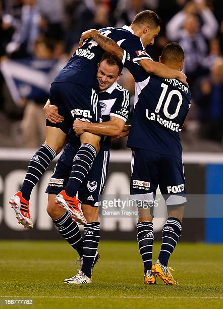 JamesTroisi of the Victory clebrates a goal with teammates during the round four ALeague match between Melbourne Victory and Wellington Phoneix at...