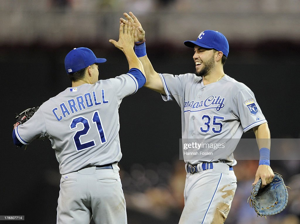 Jamey Carroll #21 and Eric Hosmer #35 of the Kansas City Royals celebrate a win of the game against the Minnesota Twins on August 28, 2013 at Target Field in Minneapolis, Minnesota. The Royals defeated the Twins 8-1.