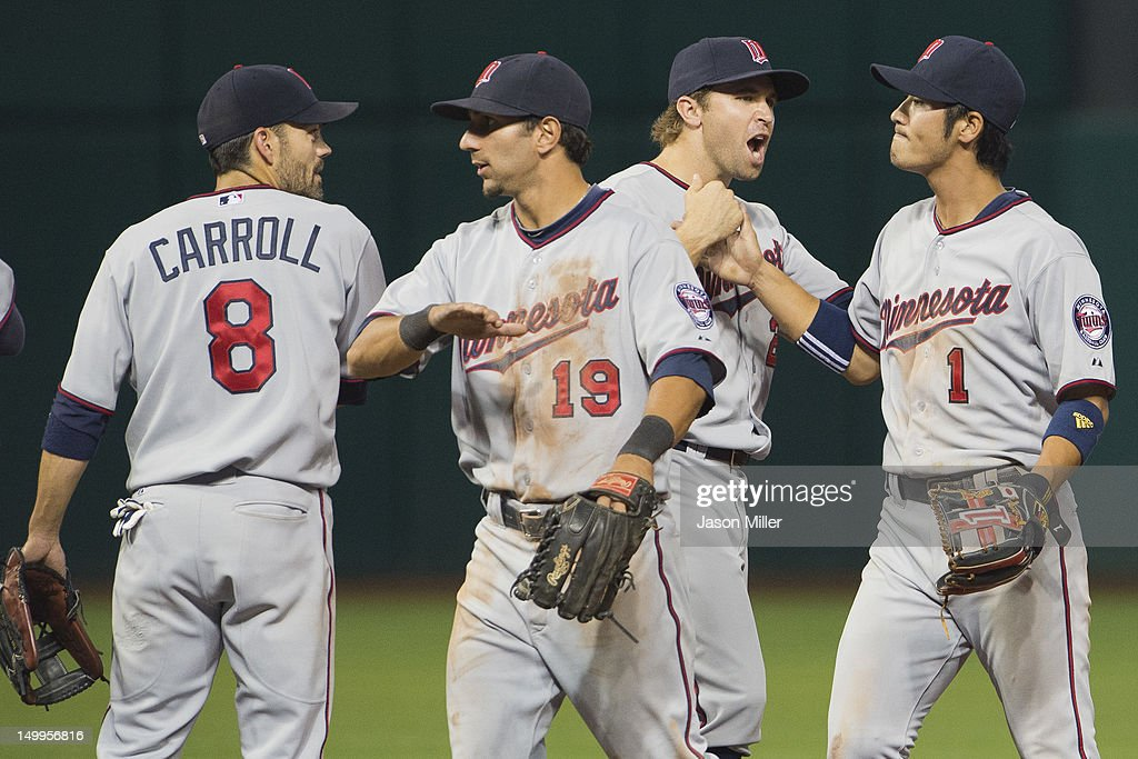 Jamey Carroll #8 Darin Mastroianni #19 Brian Dozier #20 and Tsuyoshi Nishioka #1 of the Minnesota Twins celebrates after the Twins defeated the Cleveland Indians at Progressive Field on August 7, 2012 in Cleveland, Ohio. The Twins defeated the Indians 7-5.