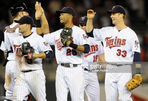 Jamey Carroll Joe Mauer Pedro Florimon Glen Perkins and Justin Morneau of the Minnesota Twins celebrate a win of the game against the Philadelphia...