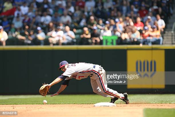 Jamey Carroll of the Cleveland Indians dives for a ball against the Seattle Mariners on July 19, 2008 at Safeco Field in Seattle, Washington.