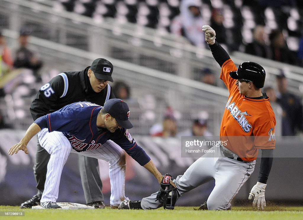 Jamey Carroll #8 of the Minnesota Twins tags out Rob Brantly #19 of the Miami Marlins at third base during the seventh inning of the second game of a doubleheader on April 23, 2013 at Target Field in Minneapolis, Minnesota. The Marlins defeated the Twins 8-5.