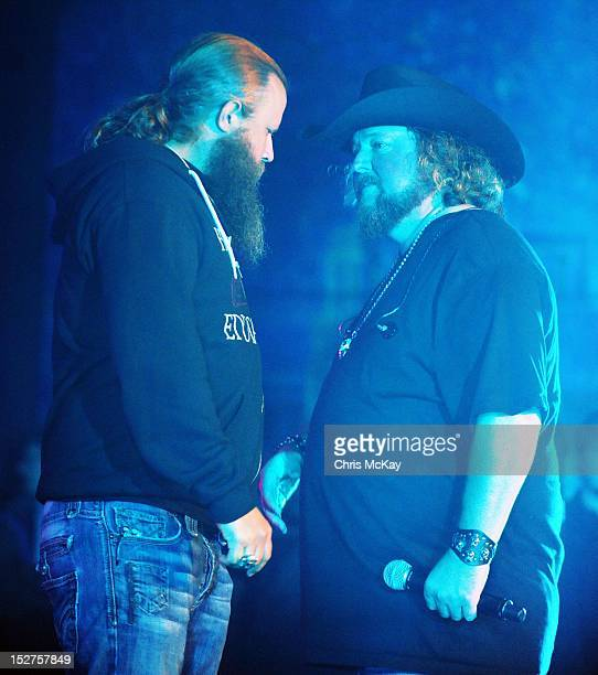Jamey Johnson and Colt Ford perform following the 2012 Colt Ford Friends Celebrity Golf Classic at Legends Golf Course Club on September 24 2012 in...