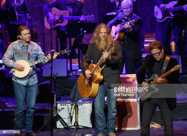 Jamey Johnson is joined on stage by Jimmy Melton and Brent Mason during the Country Music Hall of Fame and Museum Medallion Ceremony to celebrate...